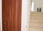 Storage room under staircase
